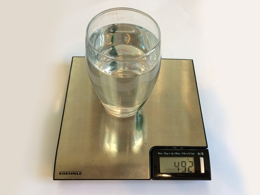 Glass of water weight with a kitchen scale