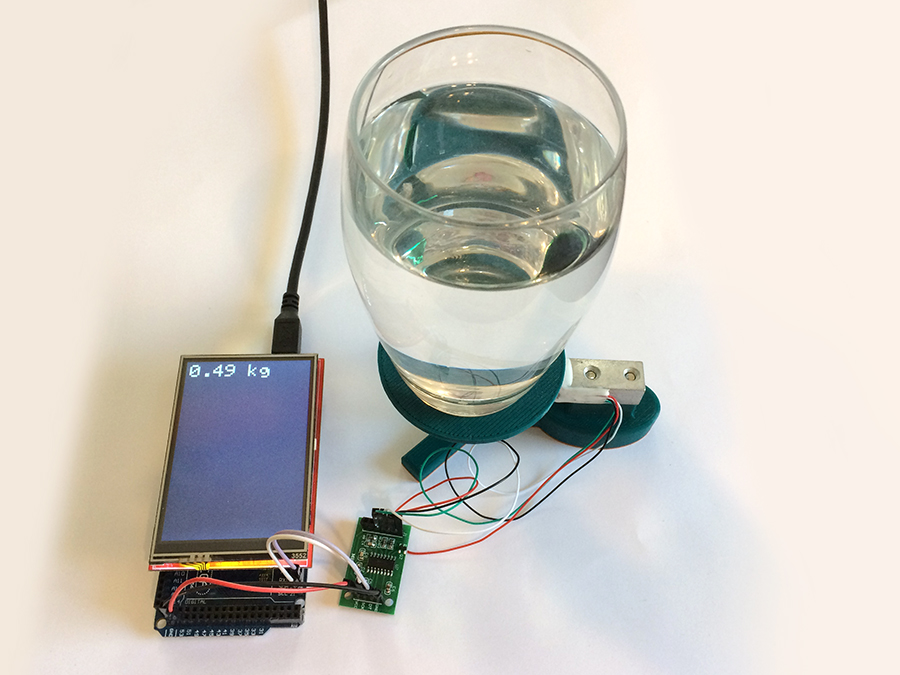 Glass of water weight with a load cell
